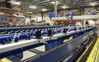 Table with Color-Coded Stud Locators, Pop-Up Roller Conveyors and Squaring Edge